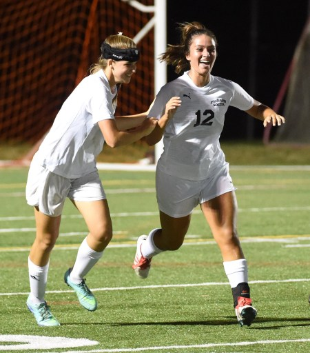 Strath Haven's Liz DeCarlo, right, celebrates her first half goal with teammate Margot Hotham in the Panthers' 1-1 draw with Conestoga Thursday. (Digital First Media/Pete Bannan)