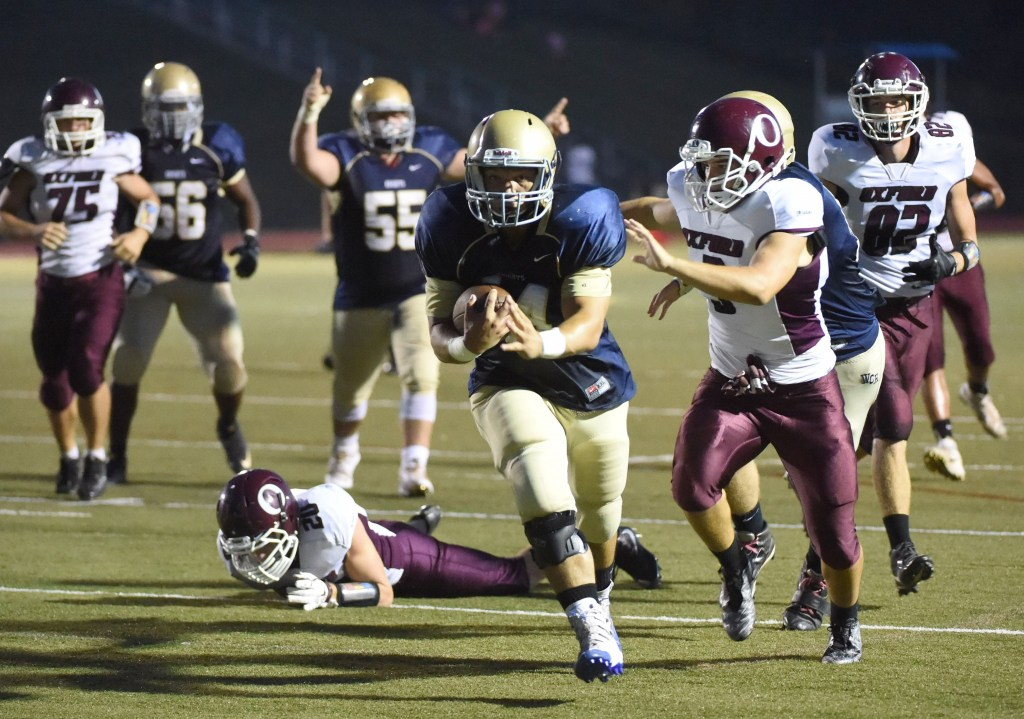 PETE BANNAN-DIGITAL FIRST MEDIA Rustin running back Kevin Sweeney scores for the Golden Knights against Oxford in the first quarter at home Sept. 23, 2016. The Golden Knights won by a score of 33-6.