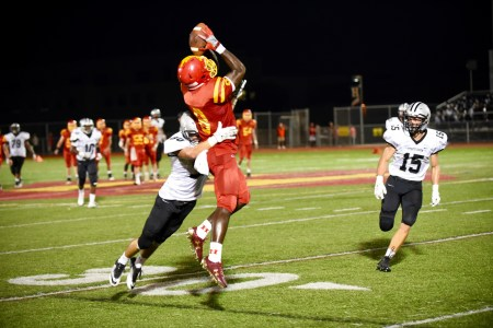 Haverford's Jordan Mosley goes up for a catch over Strath Haven defender Chip Rosini in the Fords 23-17 win Friday. (For Digital First Media/Paul Bogosian)