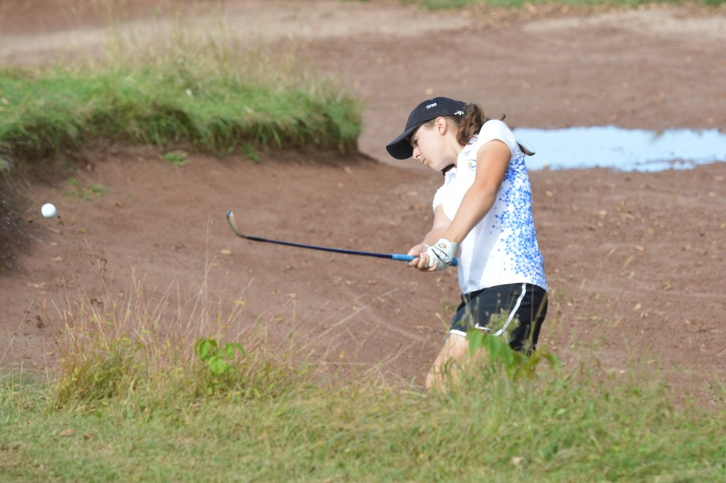 Downingtown East's Liddie McCook hits her approach from the bunker on the 17th hole. (Sam Stewart - Digital First Media)