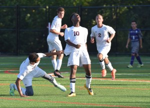 Pottsgrove's Germann Larmond (10) celebrates after setting up a goal for Mike Sereny (2) in the second half Wednesday against Phoenixville, knocking over teammate Kevin Benitez in the jubiliation. (Austin Hertzog - Digital First Media)