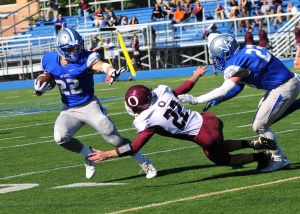 Great Valley's Mark DeRobertis looks to evade the tackle of Oxford's Nate Ferro