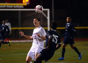 Henderson's Frank DeRosa with a header as Abdulla Barrie Approaches