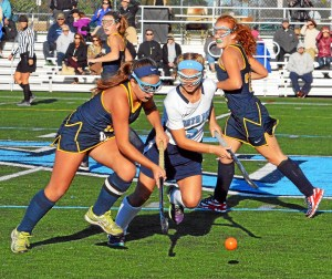 debby high — for digital first media Wissahickon's Sarah Cammarota worked to take the ball from North Penn's Bri O'Donnell on Monday.