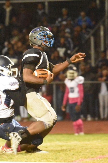 Academy Park running back Dazhon Miller, trying to elude the grasp of Penn Woods' Tyquon Brodie, racked up 167 yards and three touchdowns on just 13 carries. (Digital First Media/Anne Neborak)