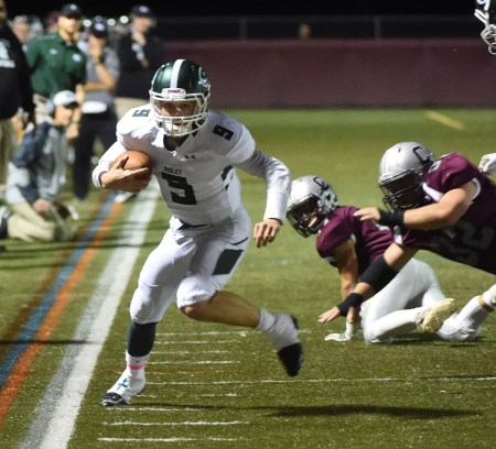 Ridley quarterback Cade Stratton dashes down the sideline early in the Raiders' victory over host Conestoga Friday. (Digital First Media/Pete Bannan)