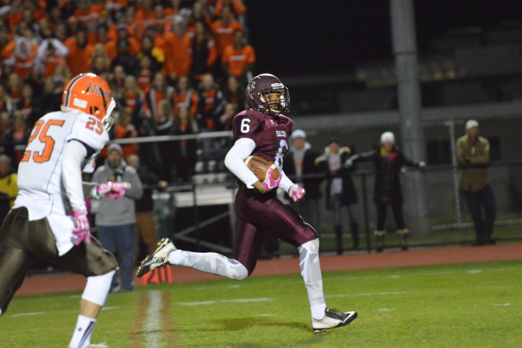 Pottsgrove's Dez Austin looks back while running into the end zone for a 37-yard score. (Sam Stewart - Digital FIrst Media)