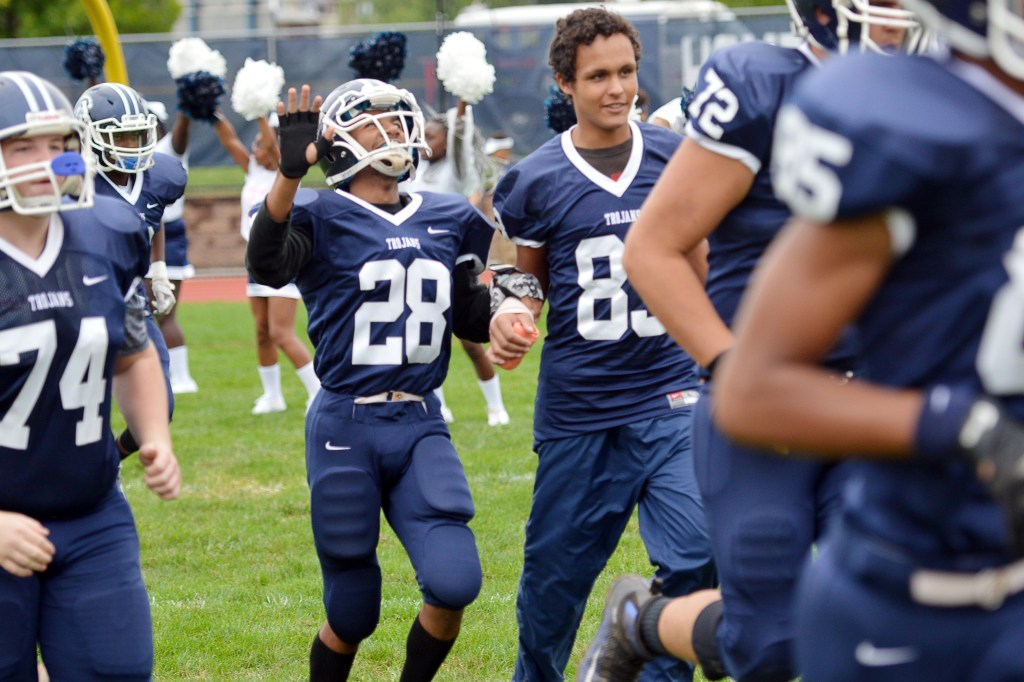 Pottstown's Marvin Pearson runs out onto the field before the Trojans' game with Pottsgrove. (Sam Stewart - Digital First Media)
