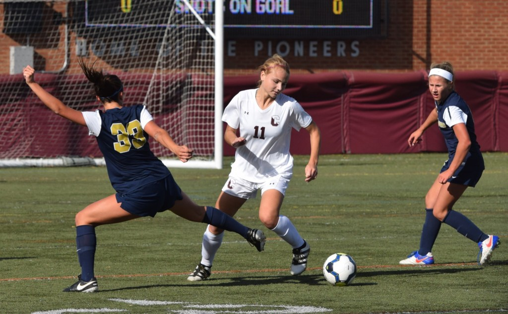 Conestoga's Hannah Morgan (11) avoids Spring-Ford's Alayna Gairo as she carries the ball forward during their District 1-AAAA girls soccer quarterfinal on Saturday, Oct. 29. (Austin Hertzog - Digital First Media)