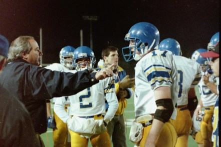 Downingtown coach John Barr and quarterback Dan Ellis go over strategy against Woodland Hills in the PIAA championship. (AMY DRAGOO - DIGITAL FIRST MEDIA FILE)