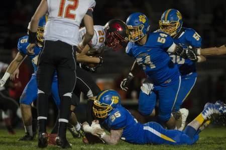 Springfield outside linebacker Dwayne Snipes (35) wraps up Penncrest running back Caleb Mahalik (20) as other Cougars defenders close in. Top-seeded Springfield pitched a shutout, 38-0, in the District 1 Class 5A opener. (Digital First Media/Rick Kauffman)