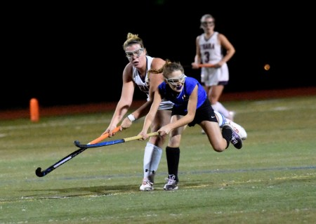 Cardinal O'Hara's Emily Quintus, left, and Downingtown West's Tatum Johnson vie for possession Tuesday. (Digital First Media/Anne Neborak)