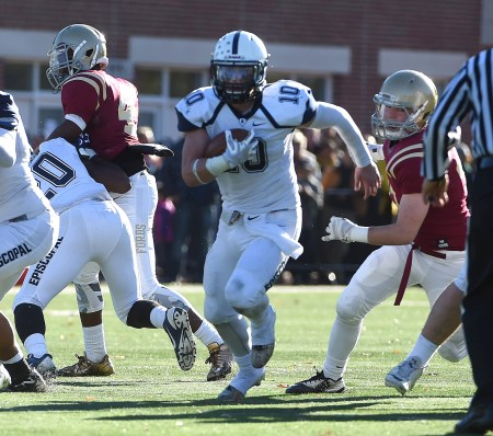 Episcopal Academy quarterback CJ McAnally bursts through the line en route to 101 rushing yards, but the Churchmen fell to Haverford School, 21-19, Saturday. (Digital First Media/Pete Bannan)