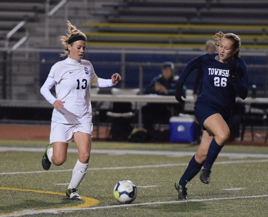 Central Bucks South's Kylie Walsh (13) carries the ball as Manheim Township's Alexa Miller-Smith chases. (Austin Hertzog - Digital First Media)
