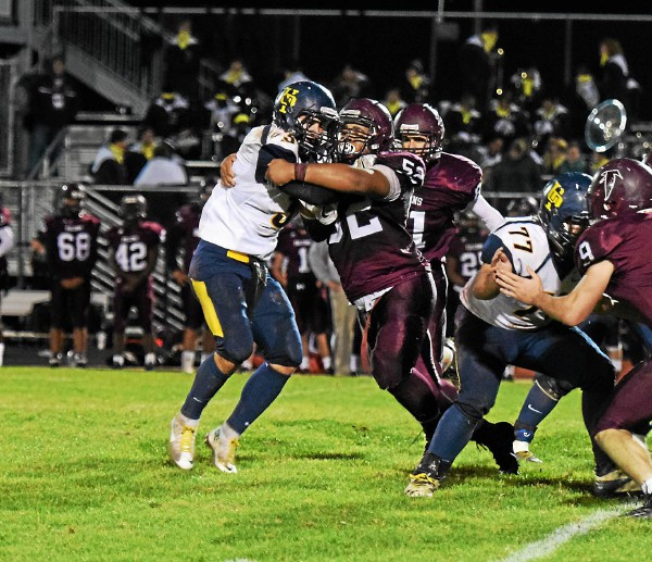 Pottsgrove's Ephraim Hurt-Ramsey stands up Upper Perkiomen's Austin Tutolo for a tackle for a loss during the fourth quarter of their District 1-4A playoff game Friday. (Austin Hertzog - Digital First Media)