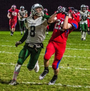 Pennridge safety Ryan Cuthbert (#8, left) covers Neshaminy wide receiver Corey Joyce in District 1 playoff opener at Nov. 4 Harry Franks Stadium, Langhorne, Pa. (J.S. Garber – For 21st-Century Media)