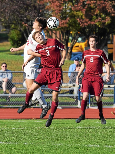 Pottsgrove's Tyler Rolando (3) and Holy Ghost Prep's Connor Fife battle for a header during their District 1-AAA boys soccer semifinal Wednesday. (Austin Hertzog - Digital First Media)