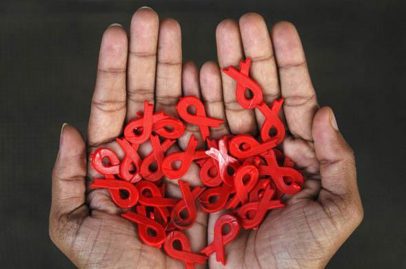 A social worker displays earrings and pendants made using the AIDS awareness symbol at a counseling centre in Chennai, India, Wednesday, Nov. 28, 2007. World Aids Day will be observed on Dec. 1. (AP Photo/M. Lakshman)