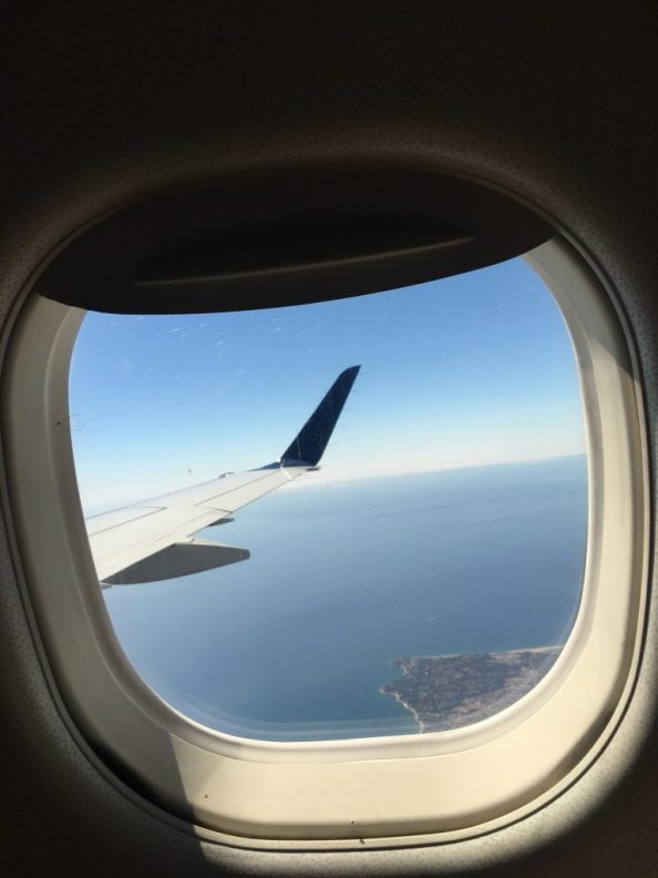 Airplane window looking out