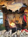 flame broiled salmon on wood planks