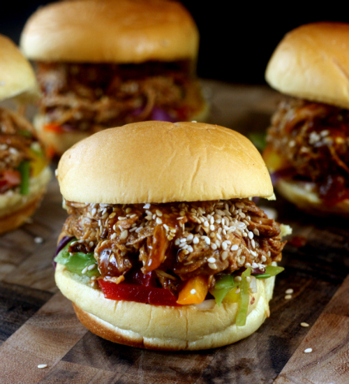 Pulled Honey Sesame Chicken Sliders with Rainbow Slaw