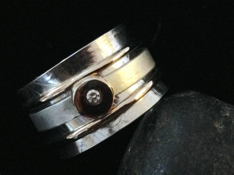 Spinner ring silver and 14kt gold set with a diamond