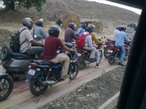 Ah! the crowds that Sam talks about so fluently... well Sam, what would you say to two-wheelers hogging pedestrian ways in Delhi?