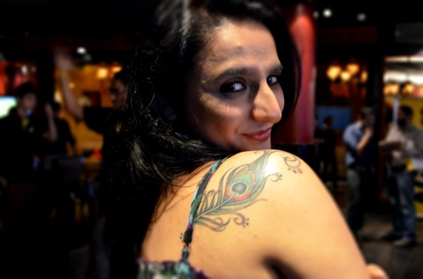 My Nikon D5100 capture Deepika's expression and her tattoo rather well.