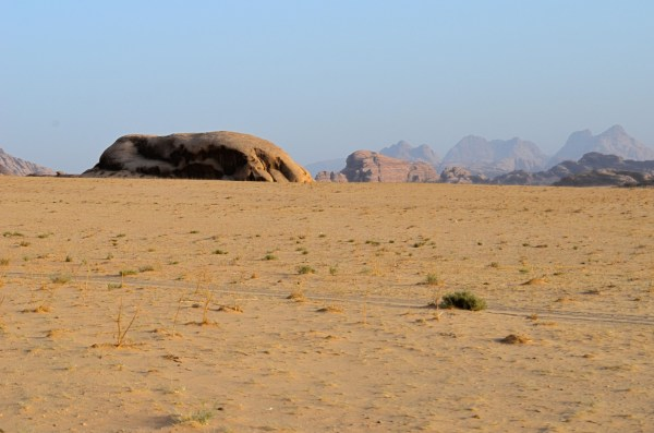 Wadi Rum, Jordan... the desert sand sits like a skull cap on massive stone structures here