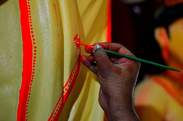 009_Durga Puja. An artist at work... the micro work is rather astonishing and my guess is that the detailing is getting more and more complex now