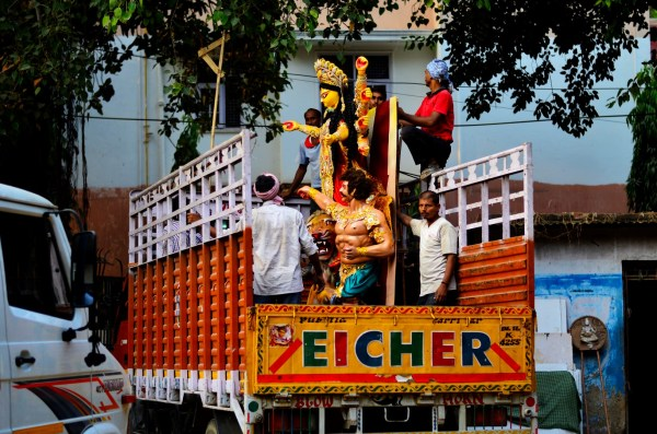 016_Durga Puja. The trucks carry the idols with at least one person assigned to each idol to make sure that the transportation is safe and secure