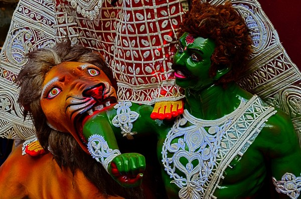 Durga Puja 2015. This lion is ferocious and the demon controlling a show of his fear...