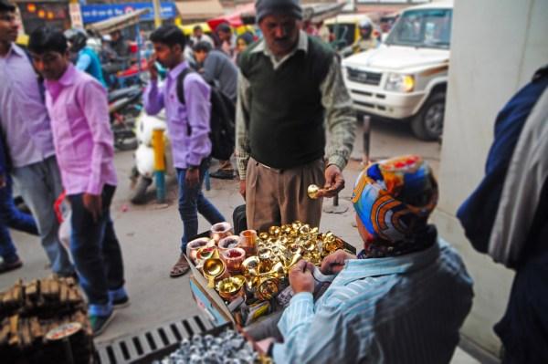 Vendors on the streets of Delhi - the brassware seller