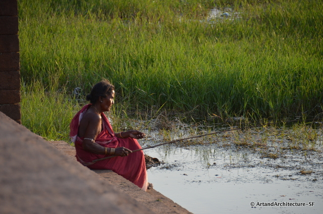 A woman fishing in the Bindusagar Tank