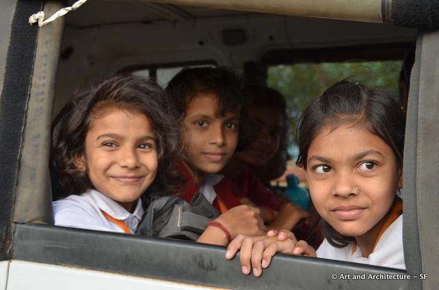 The girls riding in the school van.