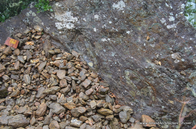 Footprints of one of the demos slain by Guru Runpoche