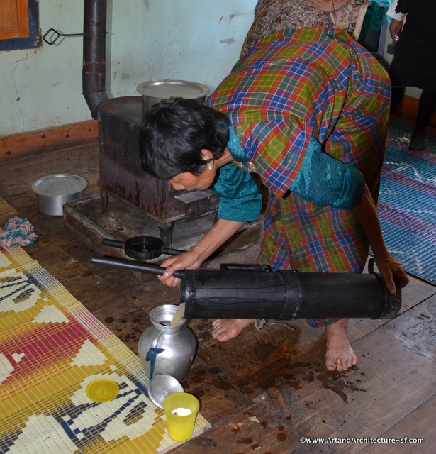 The finished butter tea being poured into a serving vessel.