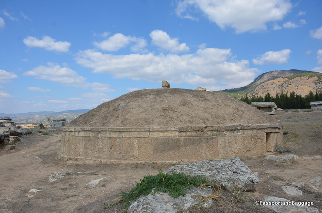 This is a tumulus. A low cylindrical drum made of travertine slabs supporting an earthen cone. It is another form of tomb and dates to the 2nd century AD with an inscription to its last occupant Lucius Salvias Paolinus