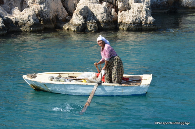 This woman rowed out to the boat to be the first to offer Thyme and other herbs.