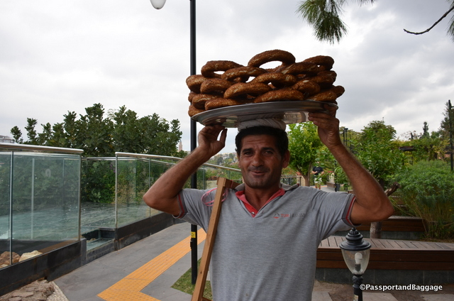 Simit is found everywhere in Turkey. It is a circular bread, typically encrusted with sesame seeds and hails from the Ottoman Empire, and the Middle East. It is typical for simit sellers to carry their load on their head, this gentleman was willing to pose for pictures after I bought a roll.