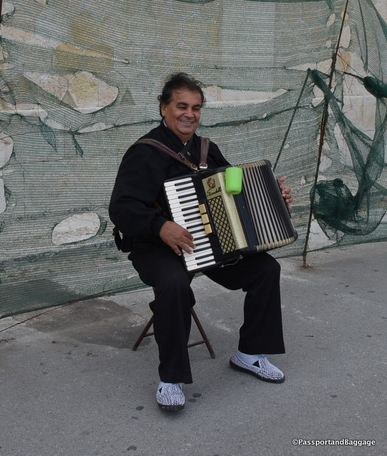 This delightful accordion player with his terrific smile was not daunted by the storm clouds