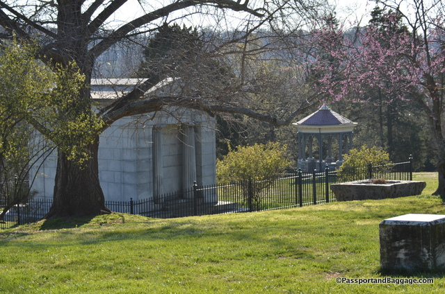 The Dooleys' Doric temple-style mausoleum sits on the property not far from the house on the ridge over the river.