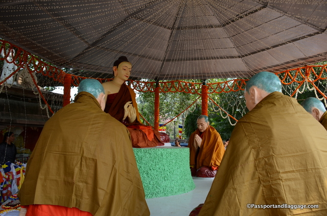 A plastic version of Buddha and 5 disciples