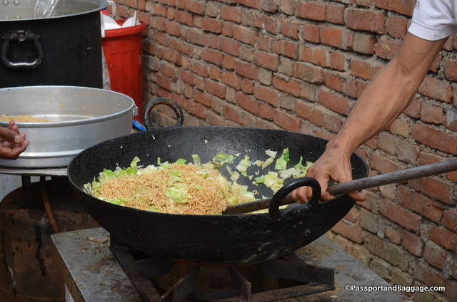 Woks, big pots and moveable burners make for dinner for 500 on the road