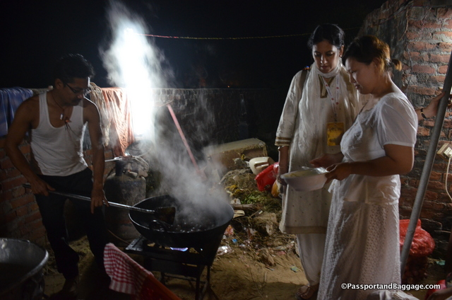 Nadia, on the left, stays up late in the evening to make sure the meals are perfect