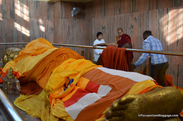Monks removing the many blankets that had accumulated in just a few hours