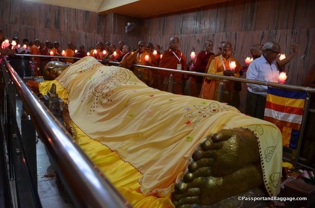 Laying the cloth on the Buddha