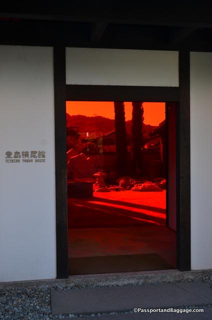 All the glass in the house is red, creating a perfect environment inside for the art.