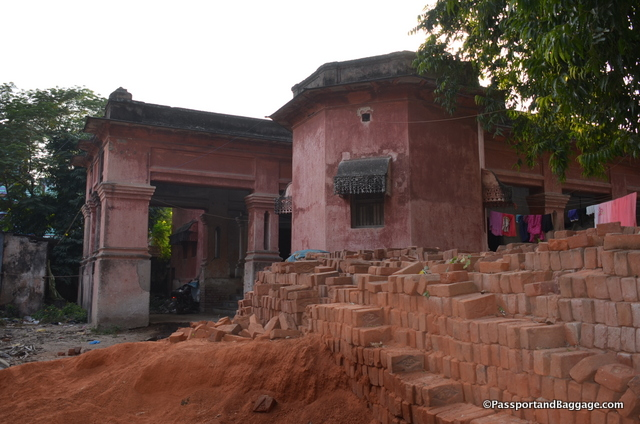 Just past the votive stupas is this beautiful red, very British looking building. It is a home for squatters.