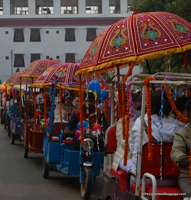 The important monks rode in highly decorated tuk-tuks